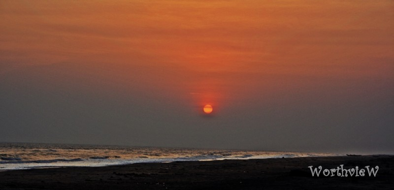sunset at perupalem beach